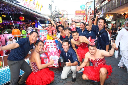 Hilton Pattaya General Manager Philippe Kronberg (kneeling, center) celebrates with employees at the finish line.