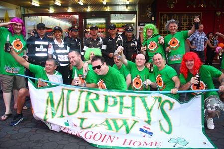 Murphy's Law poses with the Thappraya volunteers at the end of the race after the latter worked to ensure the safety of all the contestants and spectators.