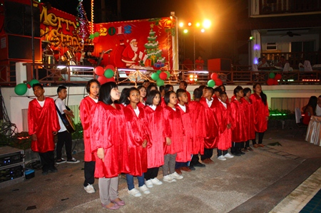 Children from the Father Ray Foundation sing Christmas carols at Diana Inn Hotel.
