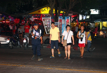 Thappraya 2013 volunteers working hard to provide safety for tourists and facilitating traffic on Pattaya Naklua Road.