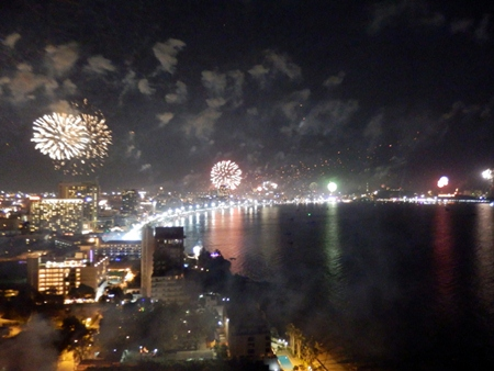 Pattaya Bay is lit up with fireworks, as seen from the top of the Cape Dara Hotel. (Photo by Peter Malhotra)