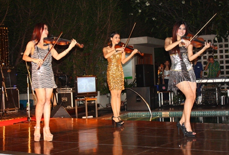 Violinists perform a live concerto as part of the gala countdown activities at Holiday Inn Pattaya.