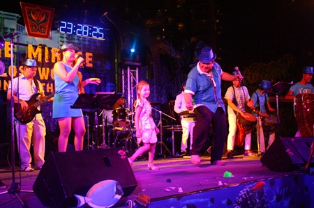 A youngster takes to the stage, joining the music performance at Centara Grand Mirage Beach Resort Pattaya.