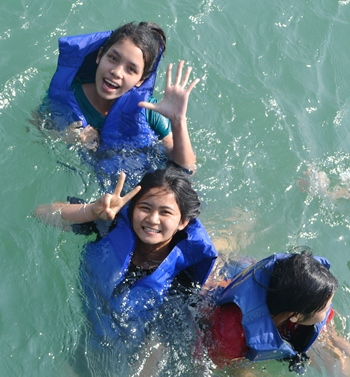 The usually shy girls enjoyed a day in the water.
