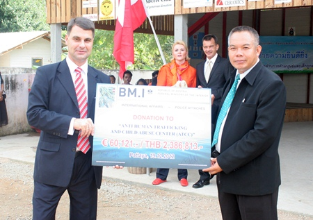 Ambassador Dr. Johannes Peterlik hands over a check to Supagon Noja, the director of the ATCC.