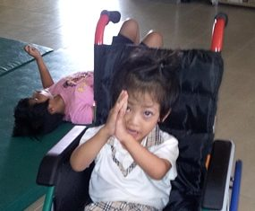 Here is Fahsai in her new wheelchair thanking all of you with a big 'wai'.