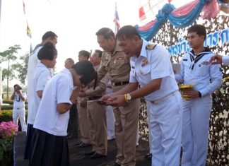 Capt. Sompong Phuwieng leads a presentation of 88,500 baht in scholarships.