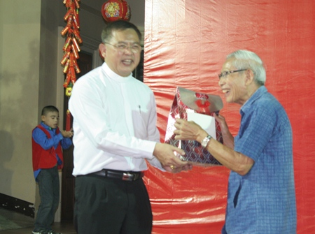 Bishop Silvio (left) honors Rev. Joseph Yuttichai Panchasap (right) for his 50th year in the priesthood.