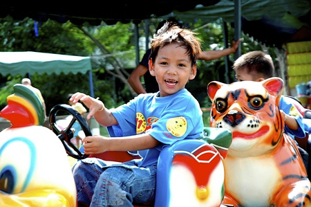 This boy on the carousel is certainly having a great time on fair day in 2008.