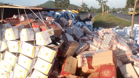 Party delayed - Yongyuth Srimawong escaped serious injury when his beer truck overturned, but the same can't be said for his amber cargo.