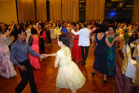 Guests take to the dance floor during the Red Cross fundraiser at the Zign Hotel, Pattaya.