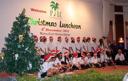 Children from the Regents School sing Christmas carols.