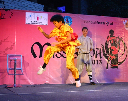 Hi ya! Another student takes to the air during his Kung Fu performance.