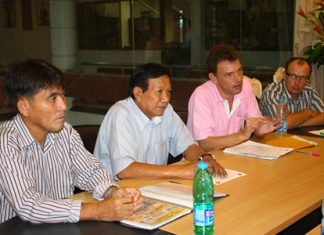 Pierre Antoine, President of the Petanque Kao-Rai Pattaya Club (2nd right), discusses preparations for the 3rd Petanque Star Masters Thailand tournament with club members and officials at Pattaya City Hall, Dec. 11.