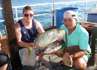 Lee Gerrard (left) and his brother in-law (right) hold up a beautiful trevally and a couple of nice sized snapper caught on Jan. 14.