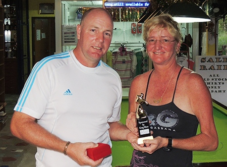Ian Heddle receives his trophy and medal from Suzi after his incredible round on Friday.