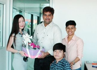 Sarinplus Leelasaowapak (left), Public Relations Manager of the Tiffany's Show Pattaya presents a gift to Tony Malhotra, Director of Business Development of the Pattaya Mail Media group to wish us well for the new year and congratulate us on the move to our new offices. Supporting Tony are his assistants, Phromlikit Kraratpetch (2nd right) and Siriporn Suksom (right).