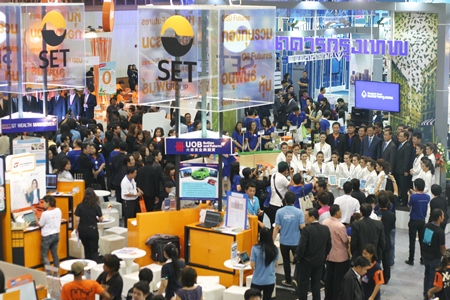 Many people crowd into PEACH conference hall for the opening day of the 3rd Money Expo Pattaya 2013.