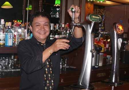 """The ever-smiling Bob presides over """"Bob's Bar"""" with all the expected beers."""