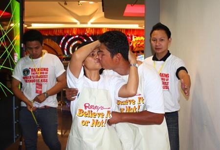Sanom Raksa and Surasak Plangklang keep kissing tightly while walking to the toilet.