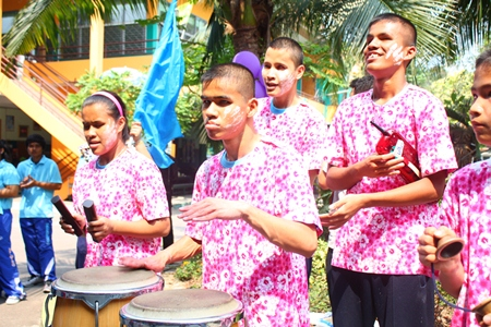 Blue team cheerleaders bang the conga drums to cheer on their teammates.