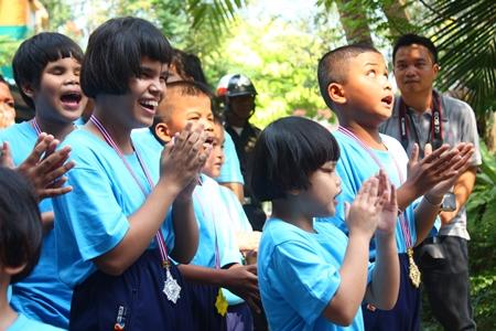 Blue team cheerleaders sing the team's cheer song.