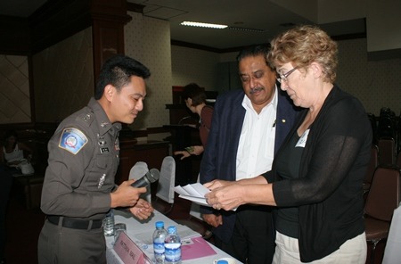 Peter Malhotra and Ann Winfield scrutinise the questionnaire distributed to expats for their comments.