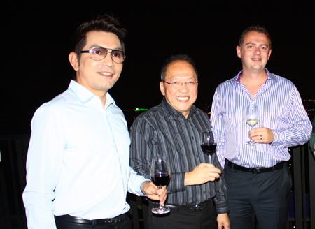 (L to R) Prayuth Thamdhum (GM Montien Pattaya) enjoys a rooftop drink with Chatchawal Supachayanont and Garth Solly (GM Holiday Inn Pattaya).