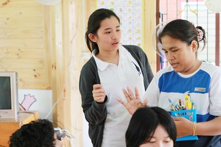 One of the IB students helps at the special school.