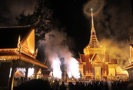 Fireworks and smoke surround the crematorium site where Cambodia's former King Norodom Sihanouk rests, in Phnom Penh. (AP Photo/Wong Maye-E)