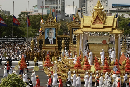 The chariot carrying the casket of Cambodia's late former King Norodom Sihanouk leads the funeral procession in Phnom Penh, Friday, Feb. 1. Norodom Chakrapong, brother of Cambodian King Norodom Sihamoni, is seen at third right at the chariot.(AP Photo/Heng Sinith)