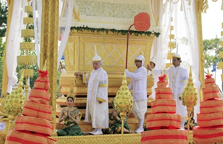 The royal guards on the chariot accompany the casket of Cambodia's late former King Norodom Sihanouk in a funeral procession in Phnom Penh, Friday, Feb. 1. (AP Photo/Heng Sinith)