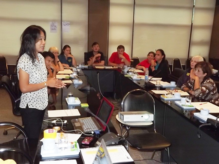 Phusa Sriwilas (left), from the Asia and Pacific office of ECPAT International, addresses a meeting of caring citizens concerned with protecting our children.