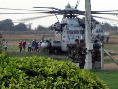 Japanese roll playing evacuees board a U.S. Marine Corps CH-53 helicopter during an Emergency Evacuation Exercise in Pattaya.