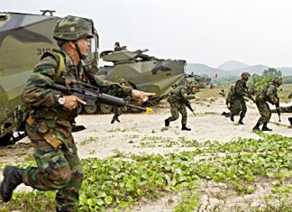 Royal Thai Marines move up Hat Yao beach during an amphibious assault rehearsal for exercise Cobra Gold 2013 Feb. 13. The amphibious assault combined the capabilities of U.S. Company A, Battalion Landing Team 1st Battalion, 5th Marine Regiment, 31st Marine Expeditionary Unit, and Royal Thai Marines in a bilateral attack as part of this year's Exercise Cobra Gold exercises. (Photo by III Marine Expeditionary Force/MCI Pacific)
