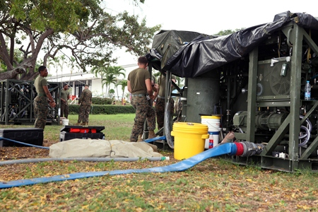 U.S. Marines from 3rd Marine Logistics Group operate a water purification system Feb. 10 in Sattahip, to provide clean water to multinational participants at various locations throughout Thailand during exercise Cobra Gold 2013. (Photo by Pfc. Mike Granahan)