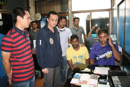 Thevarajah Gnanaraj (seated left) and Narayanasamy Mohan (seated right) have been remanded in custody for credit card theft.