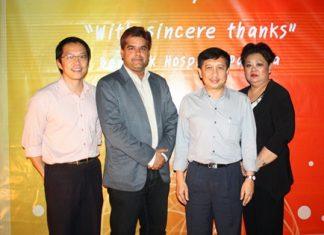 (L to R) BHP Assistant Hospital Director Dr. Tawan Chitchulanon, Pattaya Mail's Tony Malhotra, BHP Deputy Director Dr. Supakorn Winnawan, and Juthaporn Huyakorn, BHP director of Business Development and International Affairs.