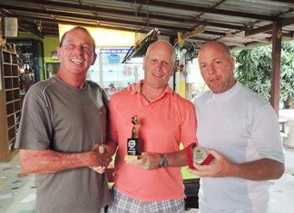 Paul Greenway (center) presents the Monthly Medal trophy to Paul Bourke (left) with low gross winner, Ian Heddle (right).