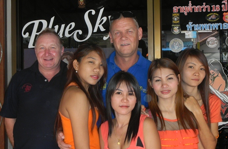 The Quiet Man and Irish John pose with the staff at Blue Sky Bar.