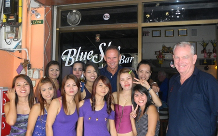 Randy & Don celebrate their golfing success with the staff at Blue Sky Bar.