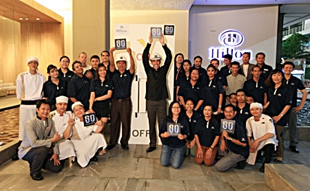 Hilton Pattaya GM Philippe Kronberg (centre right) and his staff marked Earth Hour 2013 from 8:30 p.m. to 9:30 p.m. local time on Saturday, March 23, 2013. Together with 3,900 hotels within the Hilton Worldwide portfolio of brands, citizens and organizations around the world, lights were turned off in support of action on global climate change.
