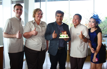 Tony Malhotra, Director of Business Development of the Pattaya Mail Media Group was feted by all his friends around town on the occasion of his birthday last week. The Hilton Pattaya had him for afternoon tea where (l-r) Simon Bender F&B director, Peta Ruiter, Director of Business Development, Dhaninrat Klinhom, Marketing and Communications Director and Senior Sales Manager presented him with a birthday cake. Back at the Pattaya Mail office, his he was met by Rungratree Thongsai (right), Public Relations Technical Officer at Pattaya City who together with the staff wish him a happy birthday with yet another delicious cake.