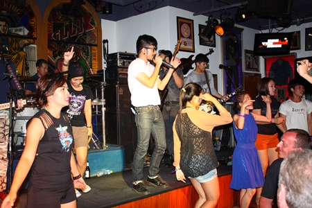 """Lead singer Laem is joined by fans on stage as he serenades them with """"Wan Dee Dee""""."""