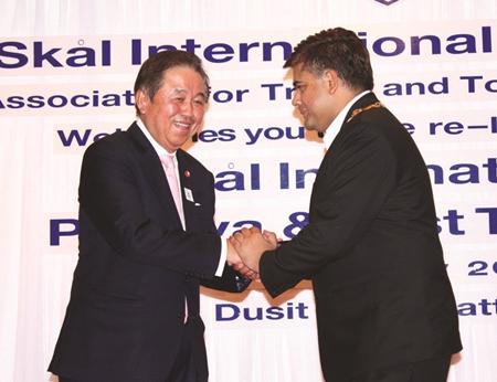 Senator Sutham Phanthusak congratulates President Tony Malhotra.
