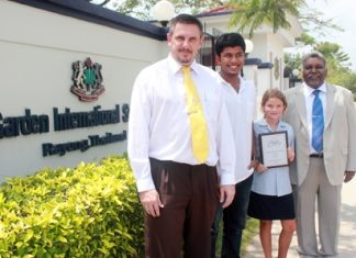 (L to R) Principal Dr Stuart Tasker, IB student Rohit Ghosh, primary student Inez Gordon and General Manager James Abraham.