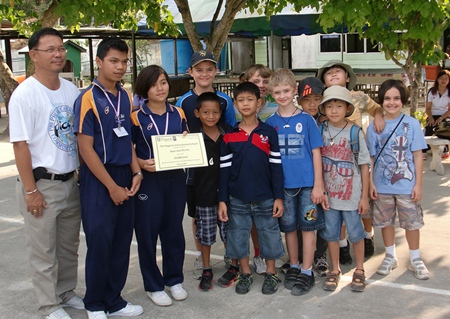 The Regent's School Pattaya students present Baan Koh Phi Phi with their donation.