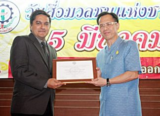 "Pattaya Mail director of operations, Kamolthep Malhotra (left), accepts the ""Most Outstanding Newspaper in all of East Thailand"" award from Chonburi Deputy Governor Pongsak Preechawit. This marks the 15th straight year Pattaya Mail Media Group has received top honors from the Eastern Mass Media Association, each year presented on March 5, National Press Day. Awarded for ""High ethical standards in business and publishing news for the benefit of society, deserving to be recognized and lauded."" This year the association introduced this highest award category which Pattaya Mail, Pattaya Blatt and Pattaya Mail Television deservedly won."
