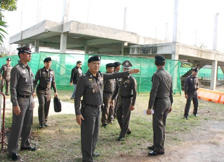 Gen. Adul Saengsingkaew (arm extended) visits the Plutaluang construction site, which still has a long way to go before it is ready.
