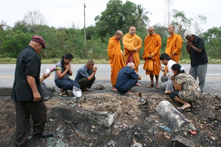 Relatives of the deceased bring monks to the site of the horrific accident to begin the long, painful process of healing their hearts.